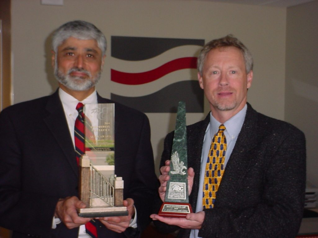 Uday Bhate and Chuck Burgin holding Associated Builders and Contractors Awards